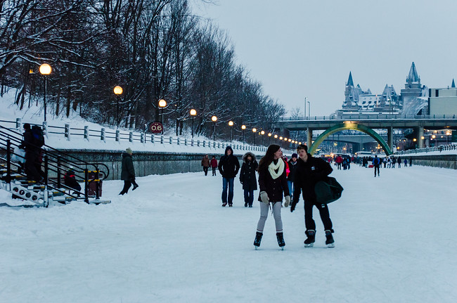 Couple ice skating in Ottawa on the Rideau Canal
