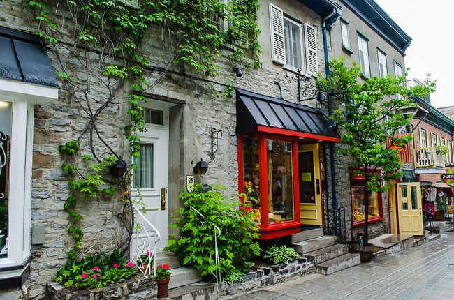 Brick and ivy covered shops in Quebec City
