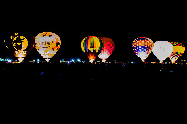 dawn patrol balloons glowing albuquerque balloon fiesta