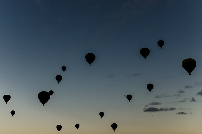 Silhouettes of Hot Air Balloons at Dawn