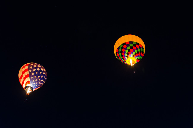 Hot Air Balloons Flying at Night in Albuquerque