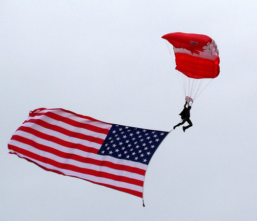 Canadian Forces Parachute Team the SkyHawks with an American flag