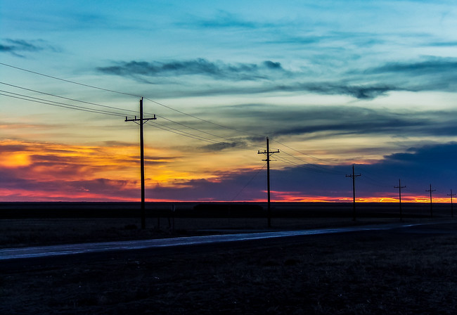 Telephone poles along the Texas Highway during Sunset